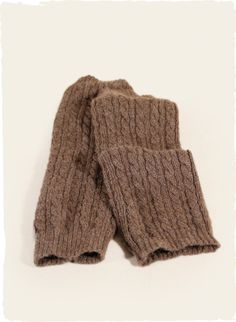 The delightfully soft and cozy legwarmers are cableknit of taupe baby alpaca. Ribbed openings.