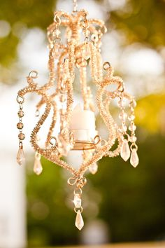 chandeliers hanging from tent