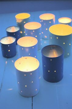 So easy, yet so cute when grouped together: tin can candle holders. Use Candle Impressions LED tea lights so the tin doesn't heat up and burn someone!