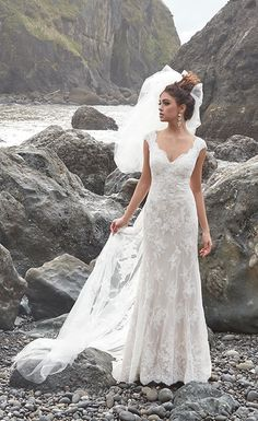 This gorgeous lace wedding dress has a beautiful sleeveless bodice with a scallo. This gorgeous lace wedding dress has a beautiful sleeveless bodice with a scalloped V-neckline and a fitted bodice in a figure-flattering A-line silhouette. Backless Lace Wedding Dress, Boho Wedding Dress Bohemian, Lace Mermaid Wedding Dress, White Wedding Dresses, Lace Wedding Gowns, Wedding Ceremony, Bridal Lace, Sleeveless Wedding Dresses, Wedding Shoes
