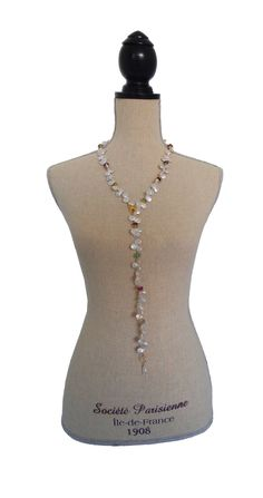 The Danilou is 36 inches long designed by Jennifer. Pearls, Florite,  Swarovski Crystals and hints of gold dipped details with a Cubic Zirconia  pave clasp make an elegant and versatile necklace. What a great addition  to your collection. It can be worn 3 different ways.