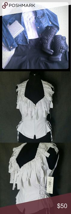 """Sleeveless Fringe Blouse NWT This flirty top is meant to be seen with its overlay of raw fringe. Features a V-neck fringe trim with center zipper and side cross bandage. Measures 20"""" from top to hem, 13"""" from armpit to pit; 1.5 - 5"""" fringe. 97% Cotton. Size 8 (M). For an edgy meets flirty look, wear it with a leather skater skirt and jean jacket. No trades or PayPal. Nygard Collection Tops Blouses"""