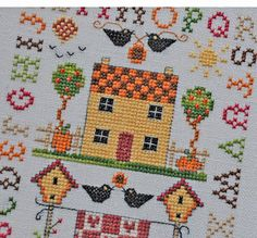 Helen Philipps: My little sampler, made a few years ago to welcome autumn, is standing on the dresser in the dining room and I remembered it too has little apples on it in the form of shiny red beads. September 2010
