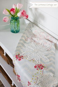 beautiful DIY table runner made with leftover fabric, dollies and hankies! perfect for valentines day or even a wedding or shower! love it! via theletteredcottage.net