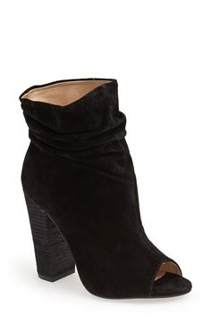 Totally pairing these stylishly slouchy peep-toe booties with boyfriend jeans, a leather jacket, and a fringe scarf for the perfect summer-to-fall transitional ensemble.