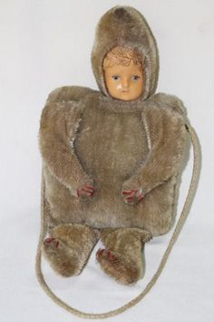 Teddy Muff - early child's muff warmer, mohair and wood wool filled body with a celluloid head, possibly English made, circa 1910.
