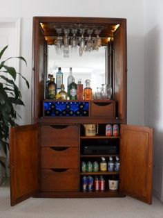 repurpose an old tv armoire into a bar! heck yes!
