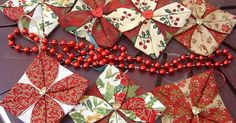 To make one of these you will need: - contrasting Christmas fabrics - a button or charm that will be sewn onto the middle - thread/ribbon f...