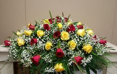 Yellow and red roses, babies breath,   295.00
