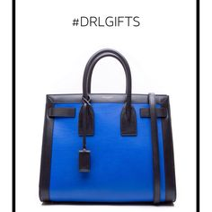 Leave her speechless with the Saint Laurent classic small sac de jour bag in cobalt blue and black leather.  SHOP ONLINE: WWW.DERODELOPER.COM