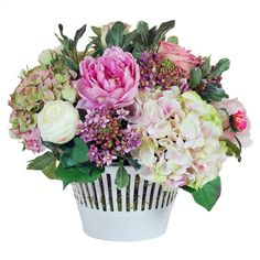 Create a lush tablescape or charming vignette with this lovely handcrafted mixed faux floral cache pot.  Product: Faux floral ar...