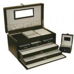You will find the leather valet box with drawers to be a multifunctional case to store a variety of items such as pocket watches and eyeglasses.    Distinguished...