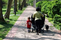 A family out for a walk in the park. Allen LaGrave Photography