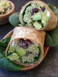 Quinoa wrap with black beans. Quinoa wrap with black beans feta and avocado. Quinoa mixed with an avocado-tahini sauce rolled up in a whole-grain tortilla. Healthy Wraps, Healthy Snacks, Healthy Eating, Healthy Recipes, Lunch Recipes, Avocado Recipes, Wrap Recipes, Yummy Wraps, Veggie Recipes
