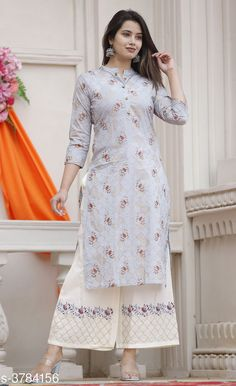 Kurta Sets Women Rayon A-line Printed Long Kurti With Palazzos Fabric: Kurti - Rayon Palazzo - Rayon Sleeves: Sleeves Are Included Size: Kurti - S - 36 in M - 38 in L - 40 in XL - 42 in XXL - 44 in Palazzo - S - 28 in M - 30 in L - 32 in XL - 34 in XXL - 36 in Length: Kurti - Up To 48 in Palazzo - Up To 40 in Type: Stitched Description: It Has 1 Piece Of Women's Kurti With 1 Piece Of Palazzo  Color: Sky Blue  Work: Kurti - Printed Palazzo - Embroidered Country of Origin: India Sizes Available: S, M, L, XL, XXL   Catalog Rating: ★3.9 (437)  Catalog Name: Women Rayon A-line Printed Long Kurti With Palazzos CatalogID_530221 C74-SC1003 Code: 585-3784156-7251