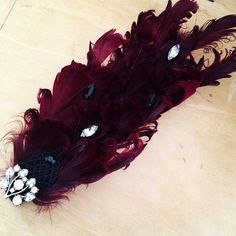 Flapper / Deco Inspired Burgundy Curled Feather Rhinestone Hair Clip on Etsy, $18.00