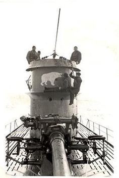 Sailors on the conning tower of German submarine U-108.
