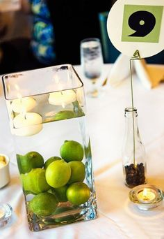 with water and candles in between long wheatgrass centerpieces