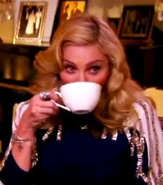 Madonna drinking coffee