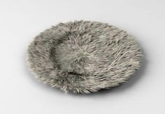 Fur plate. Imaginary redesigns of formerly useful everyday objects in Athens-based architect Katerina Kamprani's Uncomfortable series.