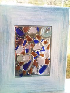 Random pieces of SEA GLASS on mirror.  Check out details on FB under NATURES PALETTE or call me, Laura at 302 745 1723. Thanks for looking!!