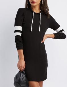 Take your sweatshirt game to sporty dress lengths with this lightweight knit mini! Varsity striped long sleeves and a slouchy, drawstring hood add an athletic flair, while a curved hem rounds out the look below.
