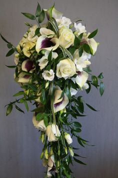 Shower bouquet of Vermeer Calla, avalanche roses, lisianthus and freesia