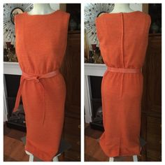 "VTG 60's Orange Wiggle Dress w Leatherette Belt This c. 60's-70's Orange knit wiggle dress by ""GENEVIEVE"" has a matching leatherette tie belt; back metal zipper & eye hook; & is fully lined in a matching sateen fabric. [Vintage] Size 8. No fabric content tag. Measured flat: shoulder-hem 40-1/2"" (2"" hem); darts at bust; under arms across chest 16-1/2""; across elasticized waist 13""; across hips 17-1/2""; 18"" across bottom. In excellent preowned vintage condition (belt has wear circles as shown…"