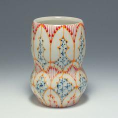Handmade Wheel Thrown Ceramic Vase with Orange, Red and Navy Pattern by dawndishawceramics on Etsy https://www.etsy.com/listing/484960581/handmade-wheel-thrown-ceramic-vase-with