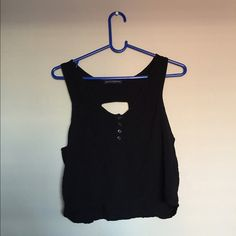 Brandy Melville Cutout Crop Top Black cropped tank  Buttons and pocket on front Cutout in back   Size: One Size ( would fit small best) Brand: Brandy Melville Brandy Melville Tops Crop Tops