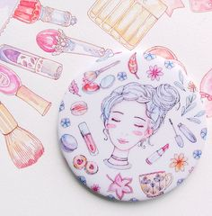 Hand mirror with a cute, colorful makeup & beauty inspired illustration print. Cute girl drawing, surrounded by autumn leaves, tea & desserts, lipstick, mascara and blush as well as some flowers for good measure. Original illustration created in watercolors.   Pocket Mirror Autumn Beauty Makeup Watercolor by evydraws on Etsy