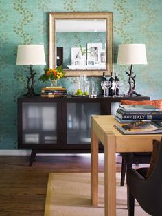 Unclutter It! I love the wall paper and lamps as well as the cabinet in this photo!