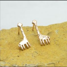 Giraffe earrings Brand new. More of a rose gold color Jewelry Earrings