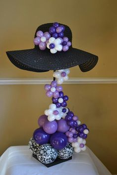#Balloon centerpiece perfect for #Red Hat Society event...using a red hat, of course.