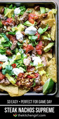 Baked nachos supreme with steak, Mexican rice, beans, cheese, lettuce, avocado, cilantro, sour cream, salsa, and serrano peppers. Great for game day, or ANY day! #glutenfree #gameday #nachos #mexicanfood