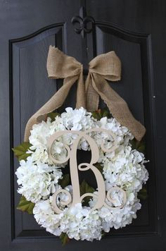 SILK white hydrangea floral wreath with a burlap bow and a monogram, great for door. This would be terrific for a wedding in fresh though