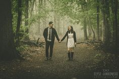 Happy Laughing Couple Holding Hands in Foggy Forest | Engagement Photos at Mills Reservation, New Jersey