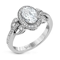 FOR THE VINTAGE BRIDE: A beautiful oval engagement ring with timeless vintage details