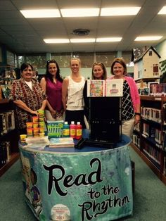"""Barksdale Officer's Spouse Club (BOSC) recently donated a karaoke machine with numerous CDs and craft items for the Barksdale Base Library, in time for the Summer Reading Program """"Read to the Rhythm."""" Shown here with Fran Morris (Library Director) are BOSC Board Members Rebecca Denton (Charitable Chairperson), Jennifer Attaway (2nd Vice President), Amy Waring (President), and Emily Meister (Ways and Means Chairperson)."""