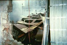 POST COLLAPSE WTC 7. Remnants of WTC 7 seen through an opening in the wall of a nearby damaged building. World Trade Center Buildings, 11 September 2001, Newspaper Article, Black Box, Solomon, See Through, Zero, The Past, Articles