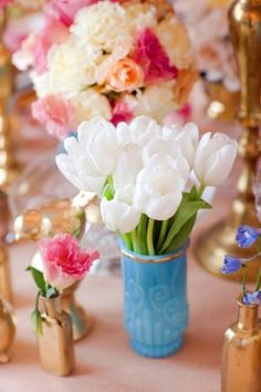 White and Pink Flowers in Turquoise and Gold Vases