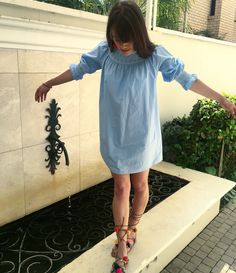 PomPom Lace-ups and a cute  embroiled slip dress. Old world style with a touch of modern style fun.