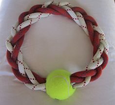 Recycled climbing rope dog tug 4 braid our by ChewsOnBelay. $20 Looks perfect for my heavy chewers! Wouldn't be hard to diy