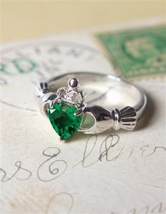 """""""This is my heart which I give to you crowned with my love."""" Claddagh rings are cast in the form of two clasped hands, symbolizing faith, trust, or """"plighted troth"""". Swarovski crystal. Sizes 5-9 (whol"""