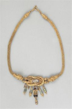 Necklace with bow of Heracles - glass paste , gold. Hellenistic period (323-31 B.C). | Louvre Museum.