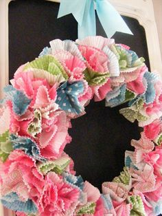 A Cheerful Wreath from Cupcake Liners (You can use holiday cupcake liners for different holidays/themes)