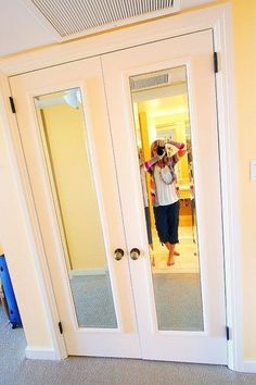 Add cheap mirrors to your closet door and paint mirror trim to match door color