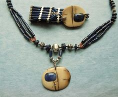 A Stunning Composition of Genuine Lapis Lazuli, 10,000 year old Mammoth Ivory and Sterling Silver.The pieces of Mammoth Ivory have an especially beautiful coloration, the natural cracks are inlayed with bronze and accentuated with sterling silver.Those will be the only pieces available, I don't have the unique materials to make another one.