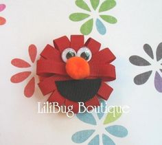 Elmo. I want to make this for Kinzee. She loves Elmo!