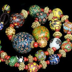 Ancient mosaic glass beads dating from Roman - Early Islamic period. Granulated gold beads from Rajasthan. Several stand out beads in this collection ...